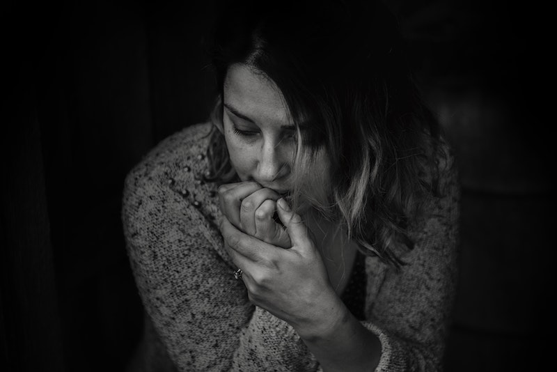 black and white image of anxious woman